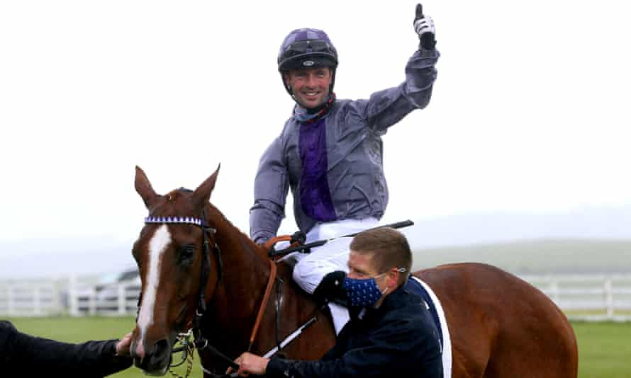 Rory Cleary celebrates on top of Mac Swiney after winning the Irish 2,000 Guineas at the Curragh