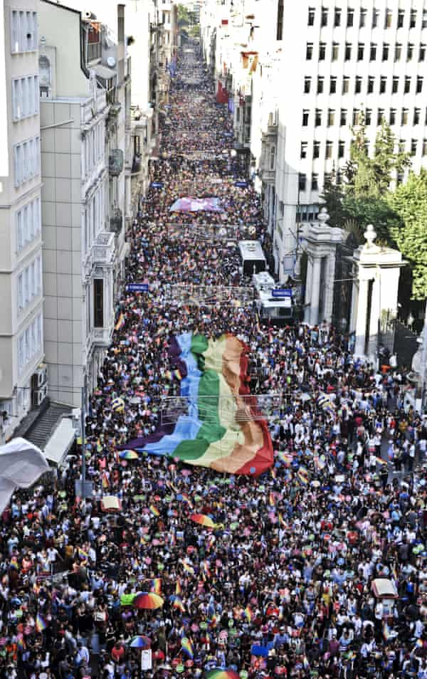 People hold a giant rainbow flag during a gay pride parade on Istiklal Street, Istanbul's main shopping corridor, in 2014.
