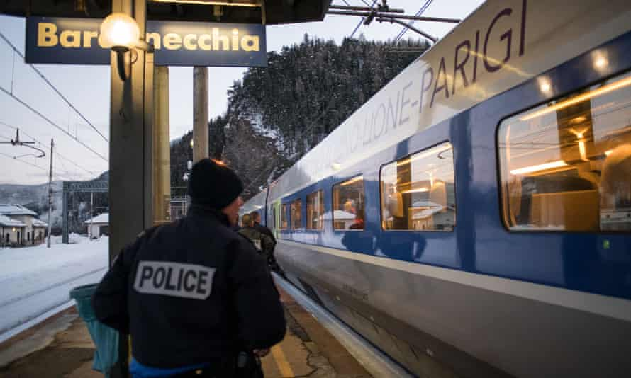 French police officers wait to board a TGV train coming from Milan and direct to Paris to control passengers at the Bardonecchia train station.