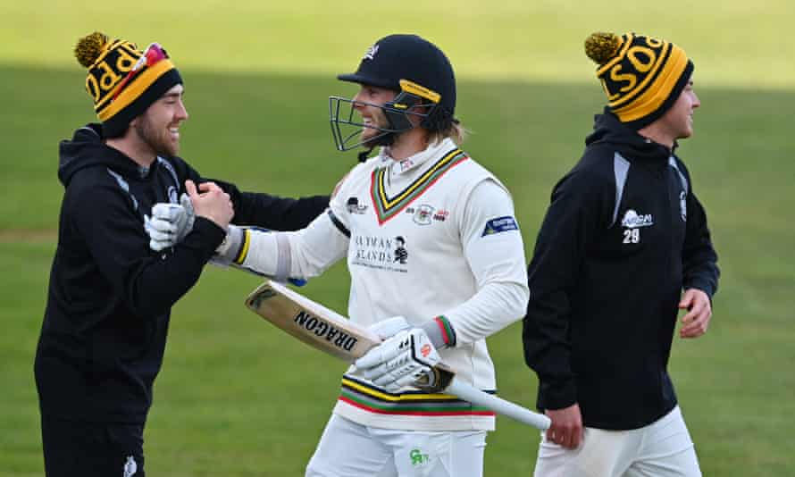 Chris Dent and his Gloucestershire teammates celebrate after their win over Surrey in the opening weekend of the season.