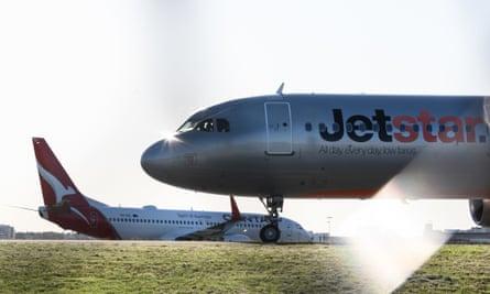 A Jetstar and Qantas aircraft on the tarmac at Sydney Airport