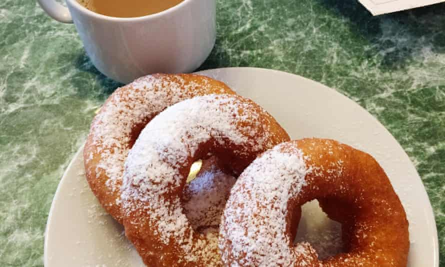 High Angle View Of Sugar Sprinkled Donuts And Tea On Table