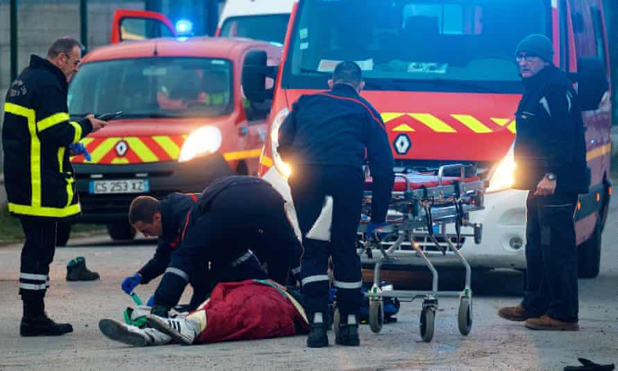 A migrant receives medical assistance following clashes in Calais.