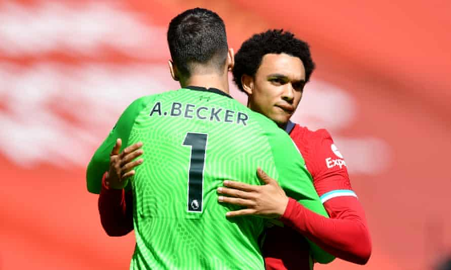 Liverpool's right-back Trent Alexander-Arnold and goalkeeper Alisson embrace before April's game against Newcastle.