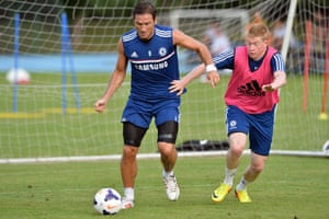 Chelsea's Frank Lampard shields the ball from Kevin De Bruyne during a training session in Bangkok during July 2013 whilst on Chelsea's pre-season tour of Asia.