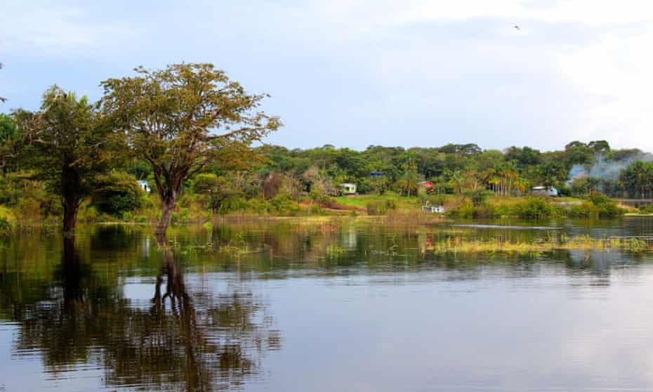 """A view of Tauary community, where ancient urns were found in late July. Re: Amazon archeology story. When they recently unearthed nine pre-Columbian funerary urns in Tauary – a tiny community in Brazil's Amazon rainforest – the immediate reaction of archaeologists Eduardo Kazuo and Márjorie Lima was, they admit, """"a mix of pleasure and desperation."""""""
