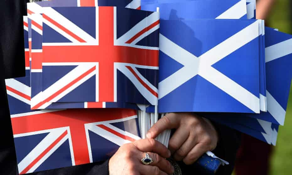 Union flags beside Scottish saltire