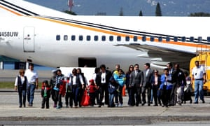 Fourteen people, four mothers and ten children, deported from US to Guatemala arrive at the International Airport of La Auroa earlier this month.