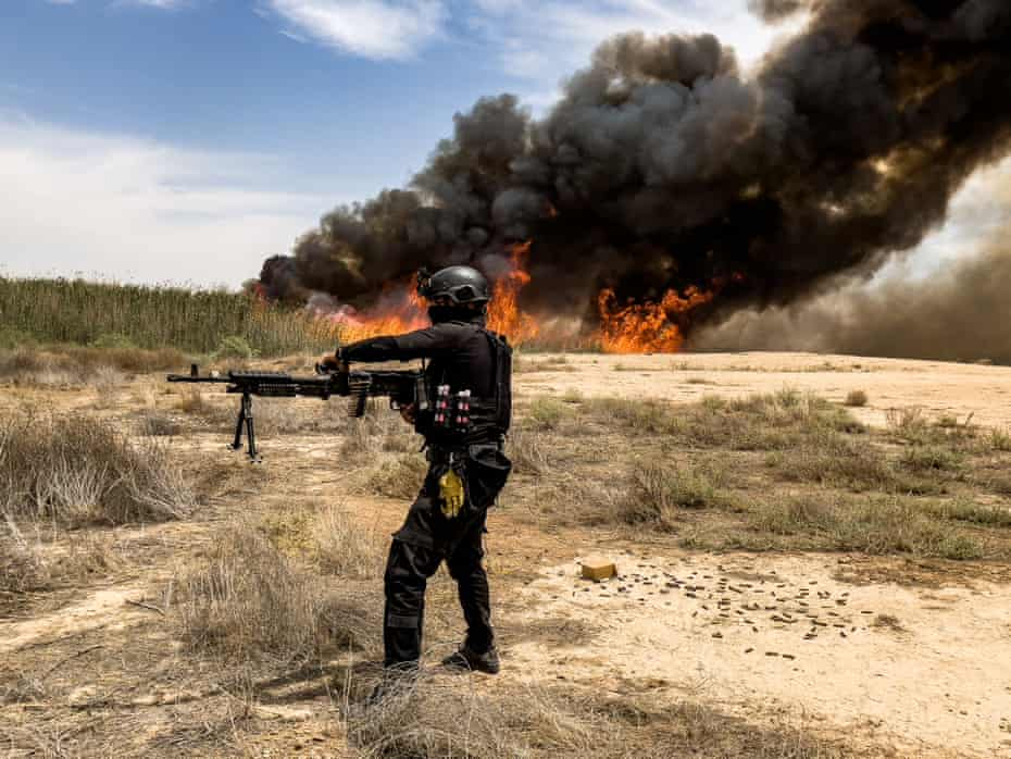 An Isof soldier sprays marshes and irrigation canals with bullets.