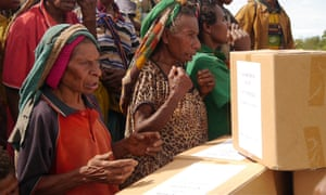 Villagers receive aid in Papua New Guinea.