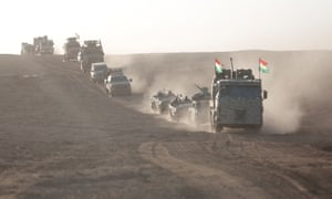 Iraqi Kurdish regional government peshmerga forces take positions as they start to attack Isis targets in Bashiqa district