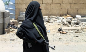 A woman holds a weapon in the port city of Aden's Dar Saad