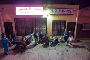 Charles uses the wheelchair, Daphne is wearing blue and Paloma, Hilda and Nora are sitting at the center, 11165 S Central Avenue, Los Angeles, 2014. Vergara, while photographing at night, has often been stopped by passersby who ask him what he is doing
