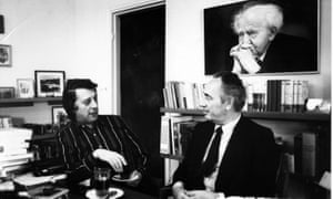 Michael Freedland, left, interviewing Shimon Peres, the former president of Israel, beneath a portrait of David Ben-Gurion, its first prime minister