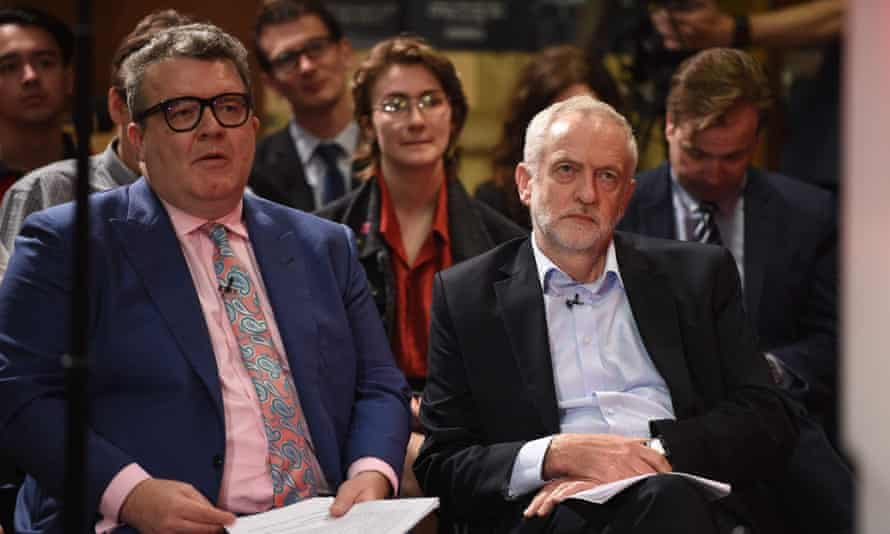 Britain's main opposition Labour Party leader Jeremy Corbyn (R) sits with deputy leader Tom Watson (L) in the audience during a general election campaign event in Kingston upon Hull, northern England on 22 May, 2017.