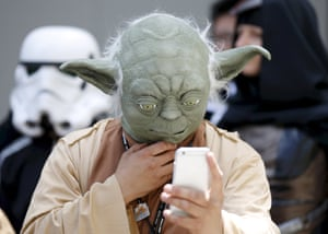 A cosplayer dressed as Yoda at a Star Wars day fan event in Tokyo.