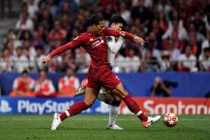 Virgil van Dijk of Liverpool tackles Son Heung-Min of Tottenham Hotspur