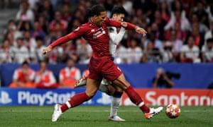 Virgil van Dijk of Liverpool tackles Heung-Min Son of Tottenham Hotspur.