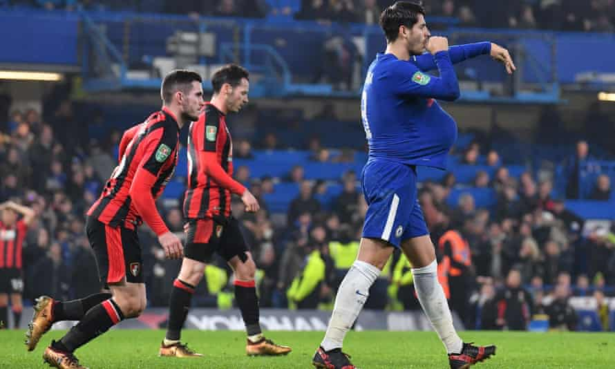 Chelsea's Álvaro Morata, right, celebrates scoring the team's second goal deep into injury time, a celebration apparently referring to his wife's recent pregnancy and which earned him a fifth booking of the season.