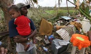 A Fijian resident  looks at the damage  caused by Cyclone Winston