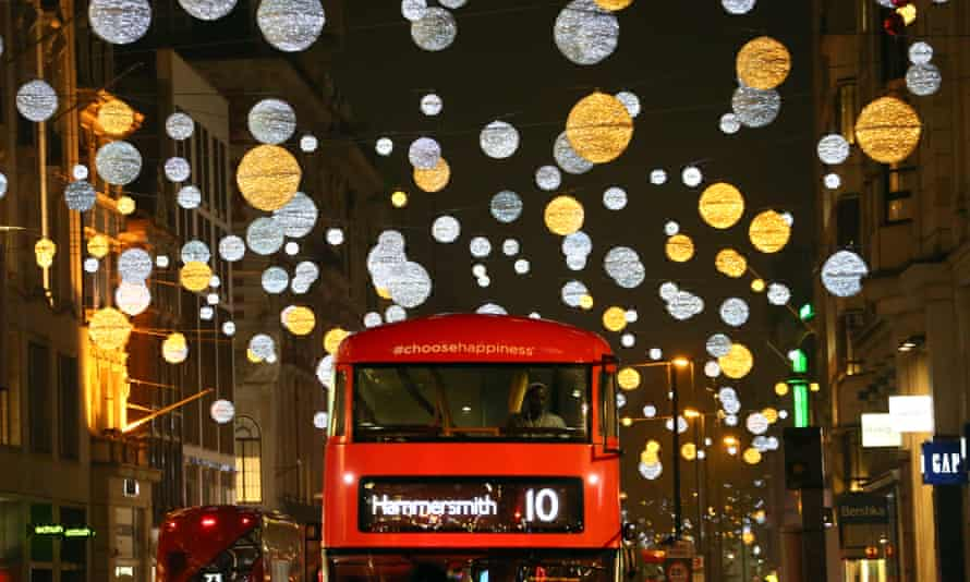 A bus plies its way down Oxford Street amid the Christmas lights.