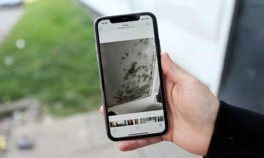 A Shield House resident, showing evidence of mould on her phone