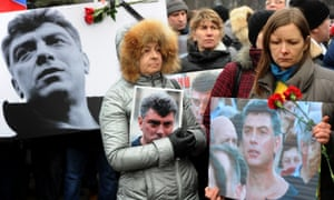 Opposition supporters hold portraits of Boris Nemtsov