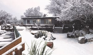 Exterior of Lake Ohau Lodge, covered with snow