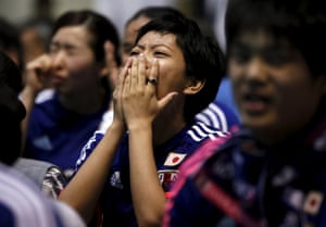 Shades of all those photos of distraught Brazilian fans in 2014 as the Brazil men's team were destroyed 7-1 by Germany. This woman looks like she can hardly believe what's happening.