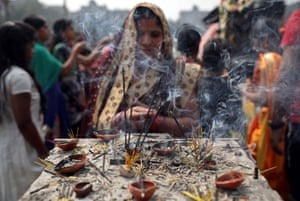 Kolkata, India: A Hindu woman burns incense sticks as she prays at a temple during the Maha Shivaratri festival