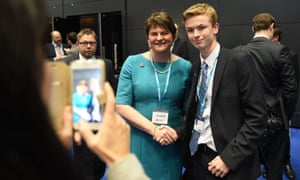 Arlene Foster poses with a Conservative party conference delegate for a picture