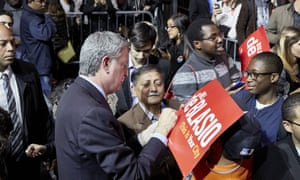 De Blasio greets attendees at a re-election rally.