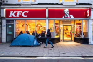 A homeless person's tent pitched outside KFC on the main shopping street on Western Road, in Brighton