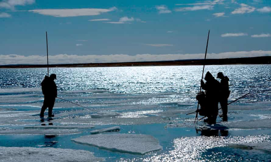 Fishing on ice in Gjoa Haven, King William Island, Nunavut, Canada. The region has witnessed a growing number of accidents in which hunters unexpectedly plunge through ice.
