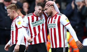 Scott Hogan (right) is congratulated by Ollie Norwood after giving Sheffield United the lead.