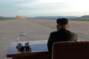 North Korean leader Kim Jong-Un inspects a launching drill of the medium- and long-range strategic ballistic rocket Hwasong-12 at an undisclosed location last month.
