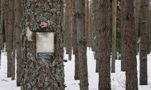 A memorial pinned to a tree at the woodland site in Sandormokh.