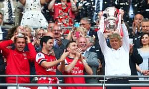 Mikel Arteta (second left) celebrates the 2014 FA Cup win.
