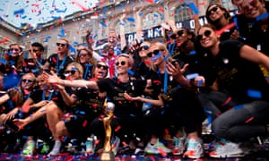 The US pose with the World Cup trophy after their victory parade in New York City