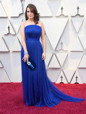 A blue dress in the shade of Democrats, Tina Fey kept it classic for the red carpet. Her sideswept hair and clutch bag added to the look. All the better to let her gags speak for themselves.