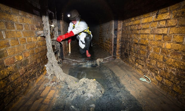 UK Water Firms Call for 'do not flush' Labelling on Wet Wipes. A member of Thames Water's sewer team points out wet wipes clogging up the sewer in Putney, London. Photograph: Felix Clay for the Guardian