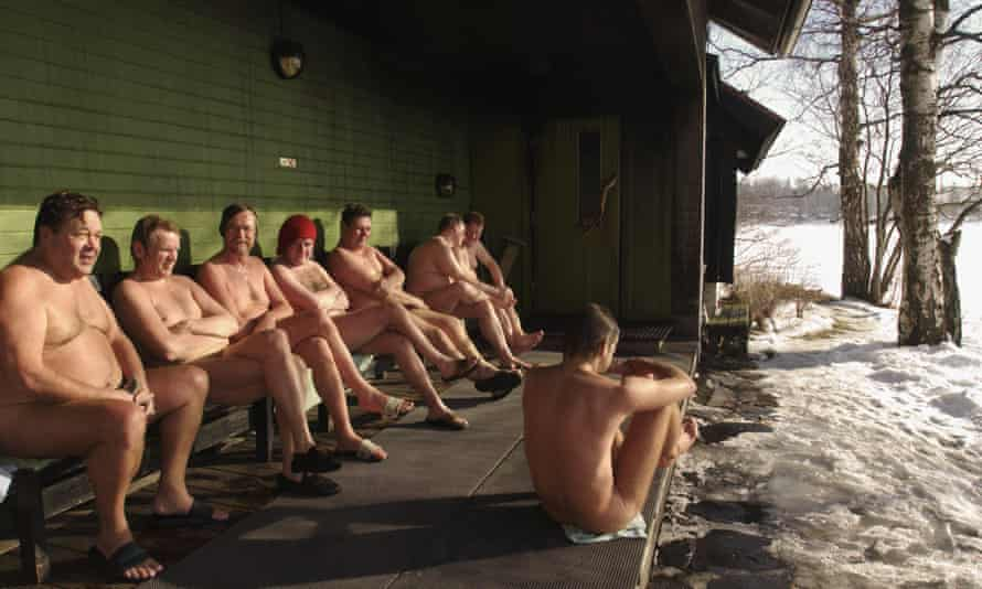 men sitting in icy surroundings