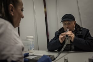 A man takes a free spirometry respiratory test during a campaign launched by two national energy firms in Chorzów