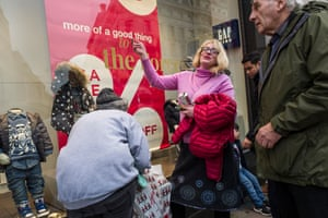 Mind the Gap: shoppers look at the retailer's Christmas window display