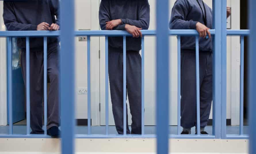 Young offenders outside their cells at Littlehey, a category C prison near Huntingdon in Cambridgeshire.