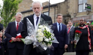 Jeremy Corbyn lays some flowers at a memorial in Birstall.
