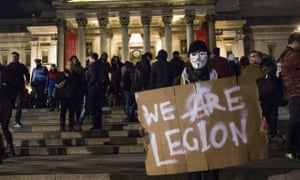 A masked protester in Trafalgar Square