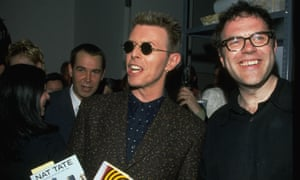 David Bowie with critic Matthew Collings – and Jeff Koons behind – at the launch party in 1998 of William Boyd's book Nat Tate: an American Artist 1928-1960.