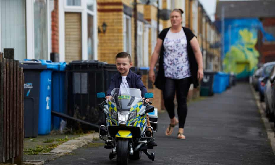 Gipsyville the ward in Hull with the highest Covid-19 infection rate where one in four children are absent from school due to a rapid rise in coronavirus cases. Alfie Field riding his new electric police with his mum Gemma as he celebrates his 4th birthday.