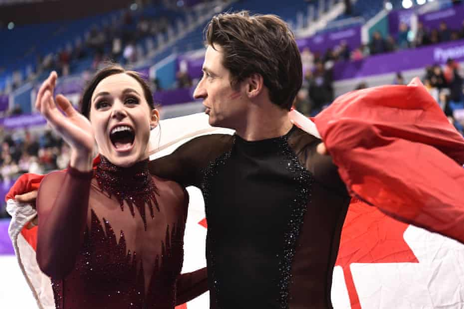 Tessa Virtue and Scott Moir celebrate after becoming Olympic champions